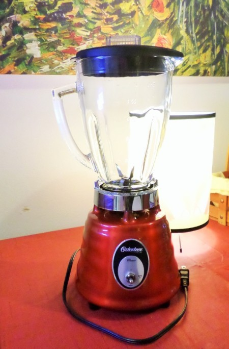 Red Blender on a kitchen counter.