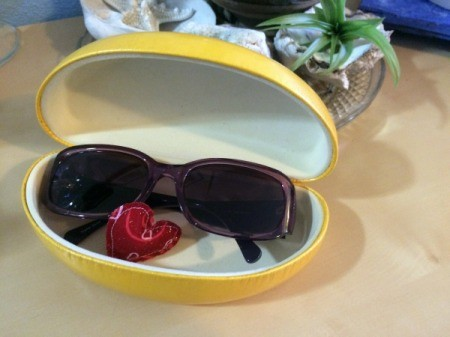heart in eyeglass case