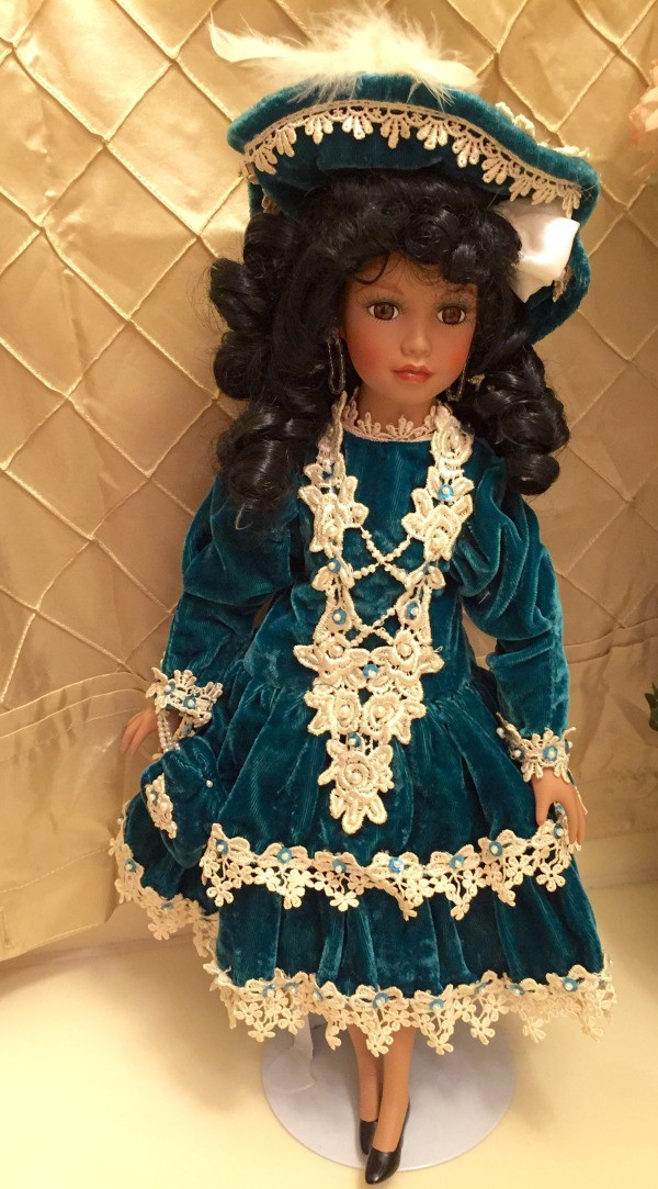 doll in green velvet dress with lace