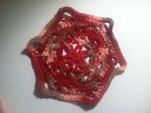 A completed crocheted flowering dishcloth.