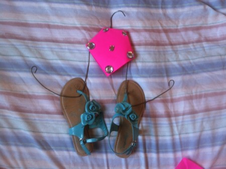 A finished recycled hanger flip flop holder.