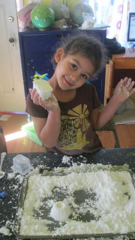 little girl with a ball of the dough