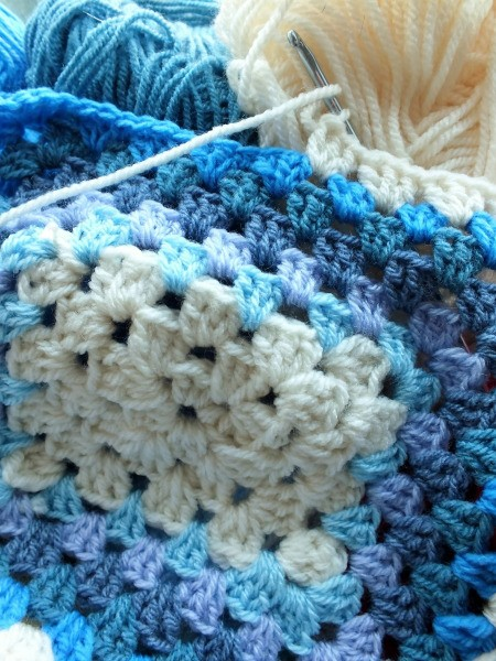 crochet granny square in blues and white