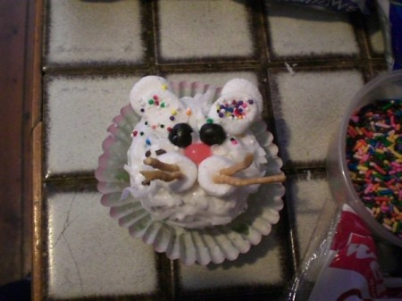 A cupcake decorated like a bunny.