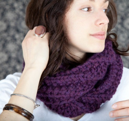 young woman wearing a purple scarf/cowl
