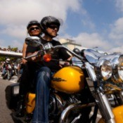 man & woman on motorcycle