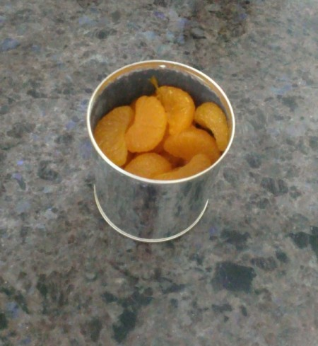 A can of mandarin oranges that has gone bad
