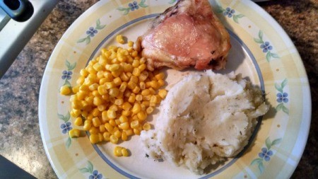 plate with corn, chop, and mashed potatoes