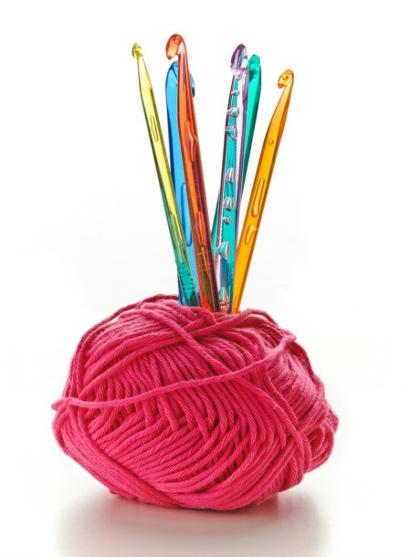 ball of wool with crochet hooks standing up inside