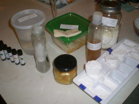 Containers filled with homemade cleaning supplies