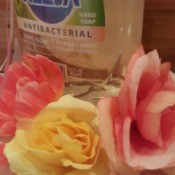 bottle of dish soap with roses in front