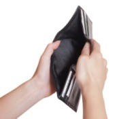A person holding an empty wallet