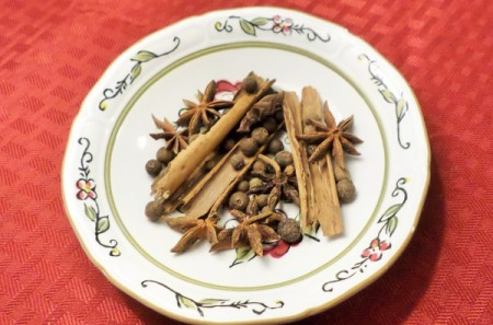 A plate of herbs and spices.