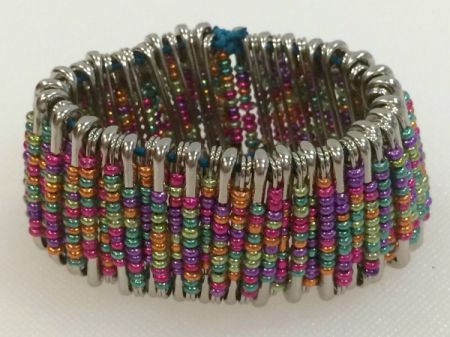 Colorful bracelet made with safety pins and beads.