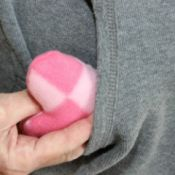 pink heart shaped hand warmer going into pocket