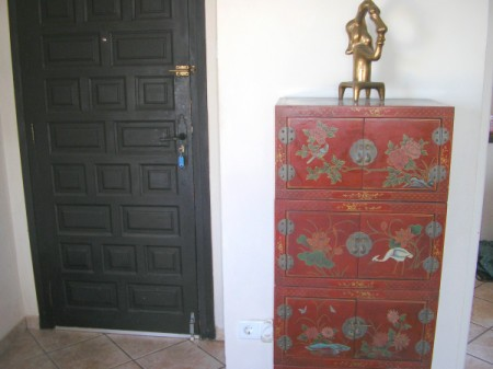 red lacquered cabinet with drawers