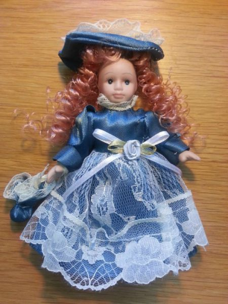 red haired doll wearing a blue dress