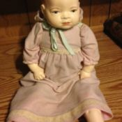 ceramic and cloth doll