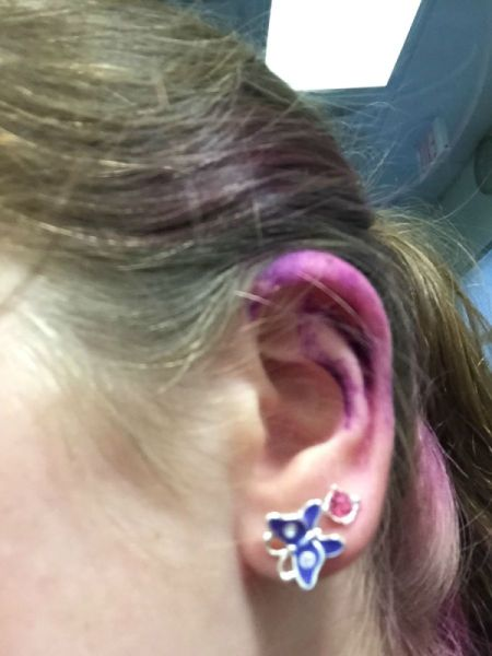 ear with purple dye on it