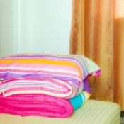 brightly colored comforter and matching pillow