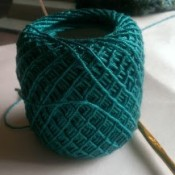 A ball of turquoise yarn.