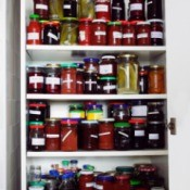 A fully stocked pantry with canned goods.