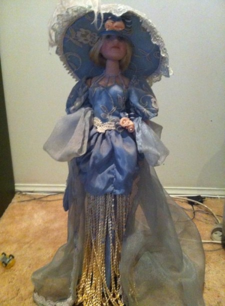 doll in blue dress with large hat