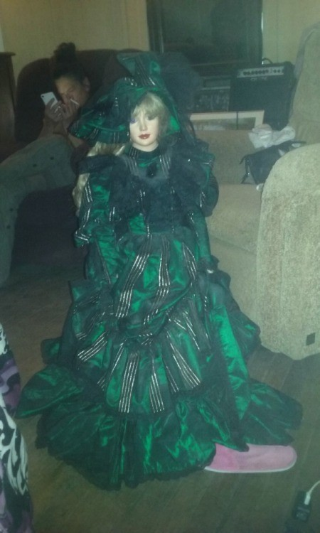 large doll in fancy green dress