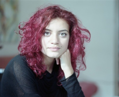 girl with curly dyed red hair