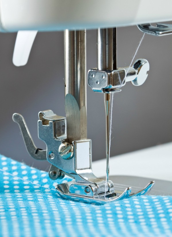 closeup of sewing machine foot and needle