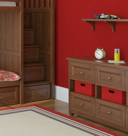 A red bedrooms its white baseboards.