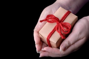 hands holding a wrapped gift