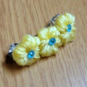 Yarn Flower Hair Clip - finished  clip with yellow yarn flowers