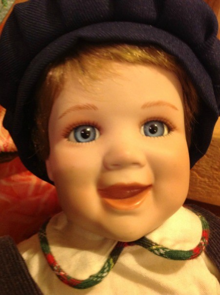 closeup of boy doll with cap