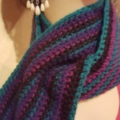 peacock striped scarf on mannequin