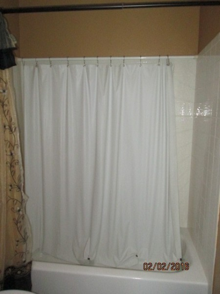 Use Second Curtain to Keep Shower Wall Clean