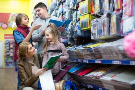 Mother, father, son and daughter shopping for stationary.