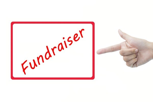 The word Fundraiser printed in red inside a red square outline against a white background.  A human hand is pointing at the word