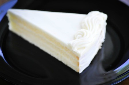 A slice of white chocolate cake.