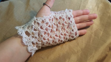 Full length old fashioned lace gloves