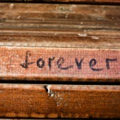 "The word ""Forever"" written in permanent marker on wood"