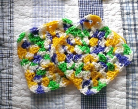 Two crocheted hot pads.