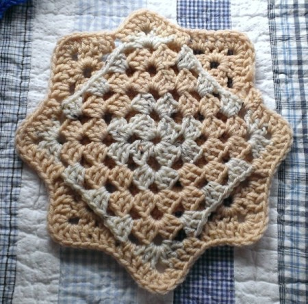 Finished crocheted coaster.