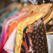 Close up of a rack of vintage clothing