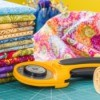 rotary cutter with a stack of fabric