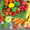Wide assortment of fruits and vegetables spread out on a table