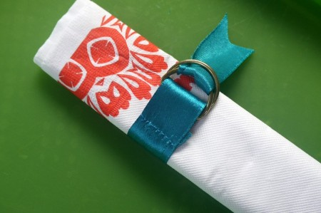 blue ribbon tie around serviette or napkin