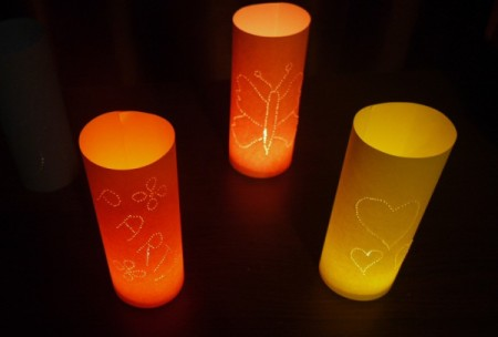 pretty lit tea lights with tubular paper shades