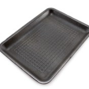 Black styrofoam meat tray against a white background