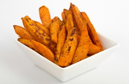 White dish with Sweet Potato Fries against a white background